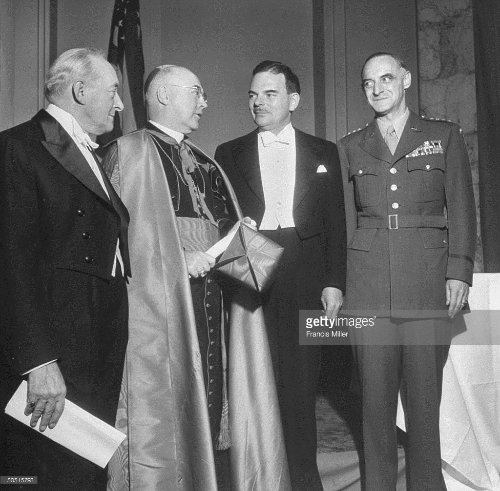 Gov. Thomas E. Dewey (2R) of New York standing with Cardinal Francis J. Spellman (2L), Charles H. Silver (L) and Gen. Lucius D. Clay (R) at a banquet.